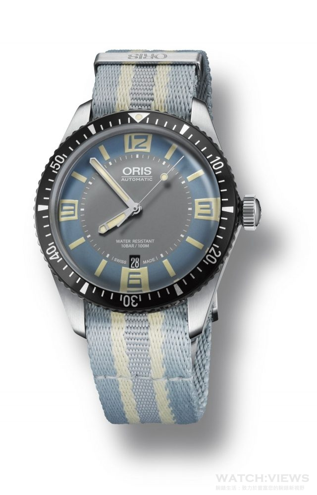 "Swiss watch manufacturer Oris launches its new Divers Sixty-Five with a two-tone grey and light ""Deauville"" blue dial option. Its dial design is inspired by 1960s colour palette, particularly the styles of upmarket French seaside resort of Deauvil"