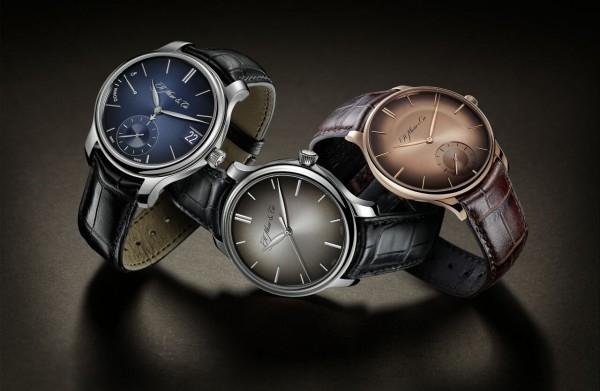fumé錶盤已經成為H. Moser & Cie.不可或缺的形象標誌 — 無論是赤(圖右)還是午夜藍色的fumé(圖左),抑或是標誌性的原型fumé(圖中)。簡潔素雅背後實則是複雜的生產過程,一項一項技術經過了反復測試和考驗。每個錶盤都以傳統的方式用機器製造而成,而後經過上色和手工修飾從而獲得著名的旭日紋圖案,這種圖案能產生奇妙的光線變化,越靠近錶盤邊緣光線會逐漸減弱,讓腕錶真正成為美的化身。