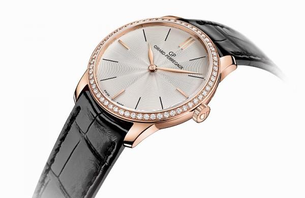 GP 芝柏表 1966 女士腕錶,玫瑰金錶殼,錶徑30毫米,錶圈裝飾:60顆明亮式切割型鑽石共約0.55克拉,時分顯示,透明琺瑯鍍銀錶盤,棒形鑲貼和塗漆時標互相交替,防水30米,芝柏表自產03300-00030-OM5A 自動上鏈機械機芯,動力儲備46小時以上,黑色手縫鱷魚皮錶帶玫瑰金錶扣。