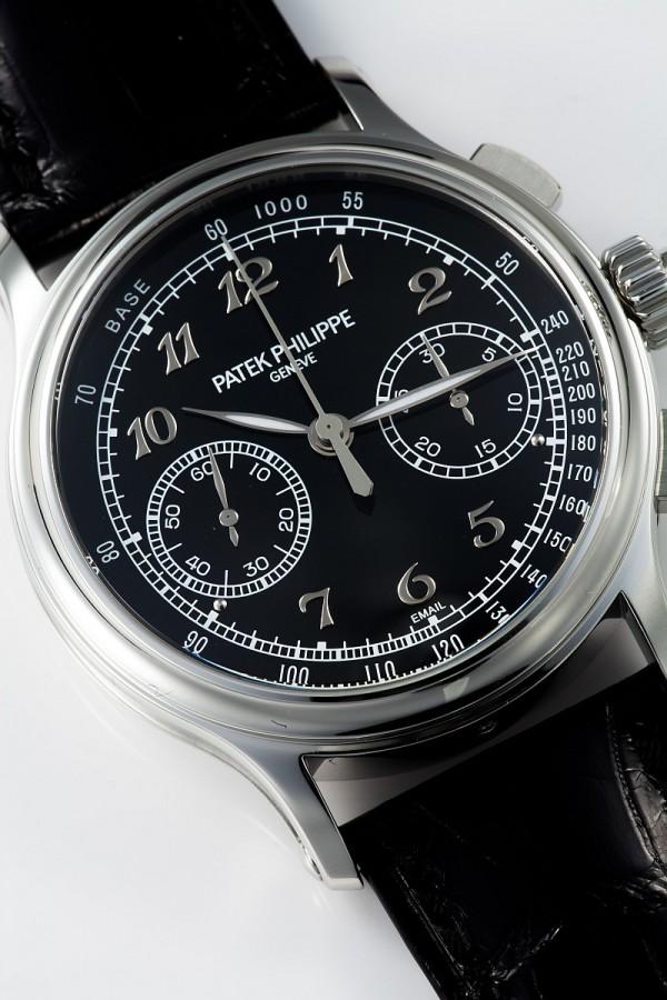 百達翡麗編號5370雙針計秒計時秒錶,950鉑金錶殼,錶徑41毫米, 6時位置錶耳間鑲有一顆頂級Wesselton鑽石,黑色琺瑯面盤,中央時及分針、計時秒針及雙針計時秒針、小秒針、30分計時盤,CHR 29-535 PS手上鍊機芯,動力儲備65小時,百達翡麗印記,防水30米,備有鉑金與寶石玻璃錶殼底蓋可供轉換,鱷魚皮錶帶附950鉑金摺疊扣。