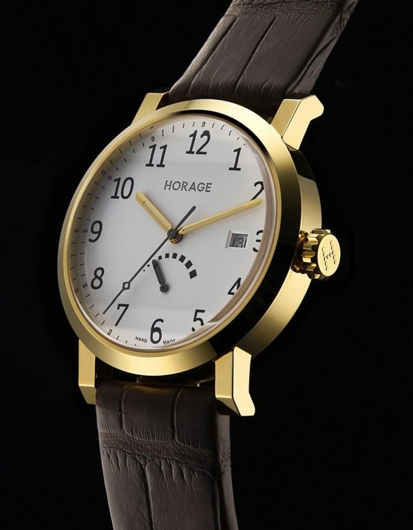 Omnium腕錶,18K黃金錶殼,錶徑39毫米,時、分、秒、日期、動力儲能顯示,自動上鍊機芯,動力儲能42小時,藍寶石水晶玻璃鏡面及後底蓋,防水30米,鱷魚皮錶帶。