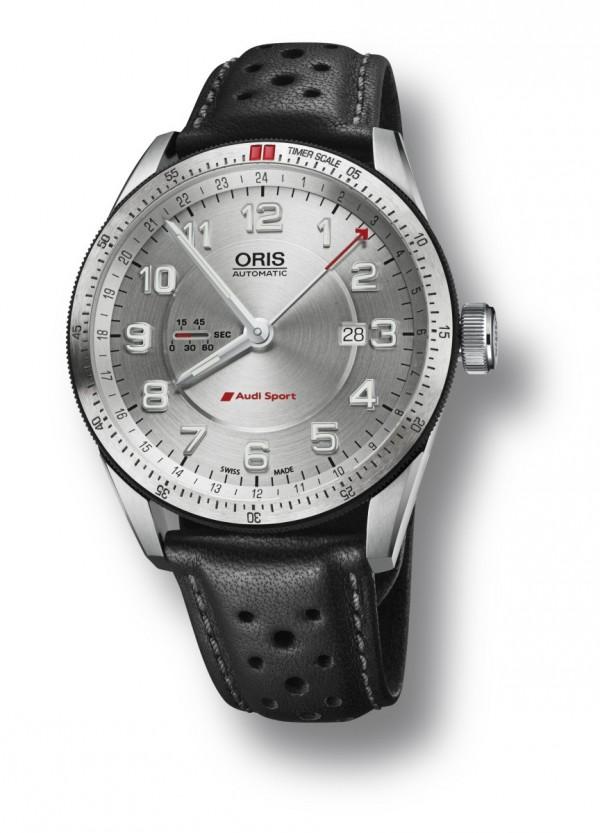 "Oris Audi Sport GMT兩地時間腕錶,型號:747 7701 4461,片式不銹鋼錶殼,錶徑44mm,Oris Cal.747自動機械機芯,與第二時區時間的24小時指針,日期視窗在3點鐘位置和Oris所開發的線性小秒盤顯示在9點鐘位置,雙向旋轉鎢上圈與分鐘刻度,""良好的抓力'的橡膠外緣,藍寶石水晶玻璃內外側防反射塗層,防水功能100米,兩片式啞光銀色錶盤與Super-LumiNova數字指標,Super-LumiNova時針和分針,銀色錶盤環24小時第二時區,賽車用的黑色打孔真皮錶帶與不銹鋼折疊錶扣,建議售價NT$69,000;亦可搭配不銹鋼鍊帶,建議售價NT$74,000。"