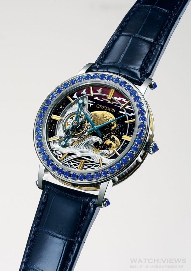 Credro富嶽(FUGAKU)陀飛輪腕錶,編號GBCC999,PT950、18K白金、18K黃金錶殼,鑲嵌藍寶石48顆(3.22克拉) ,18K白金.18K黃金雕金、螺鈿面盤,手上鍊Cal6830陀飛輪機芯,日差+15秒~-10秒,動力儲存37小時,振頻21,600次/小時(6赫茲),建議售價NTD16,500,000,深藍色鱷魚皮帶,全球限量8只。