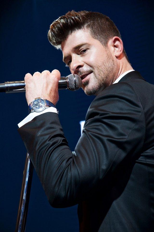 海瑞溫斯頓腕錶系列全球形象大使——著名美國歌手、作曲人及唱片製作人羅賓•西克(Robin Thicke)為當晚酒會傾情獻唱。