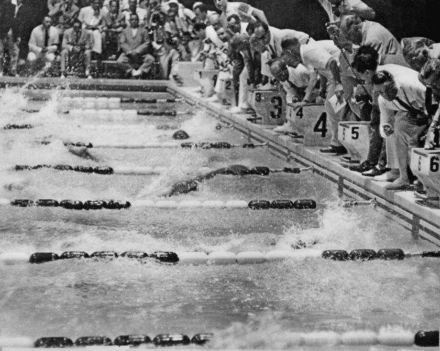 ROME, ITALY - AUGUST 28: Judges watch John Devitt of Australia (lane 3) and Lance Larson (lane 4) as they touch the wall at the finish of the 100m freestyle final, 28 August 1960 at the Olympic Games in Rome. Controversy arose at the finish line as Devitt was declared the winner by judges even though Larson's official electronic time (55 sec 10) was 6/100 faster than Devitt. Despite protest from the US delegation, Devitt's gold medal was confirmed. (Photo credit should read STAFF/AFP/Getty Images)