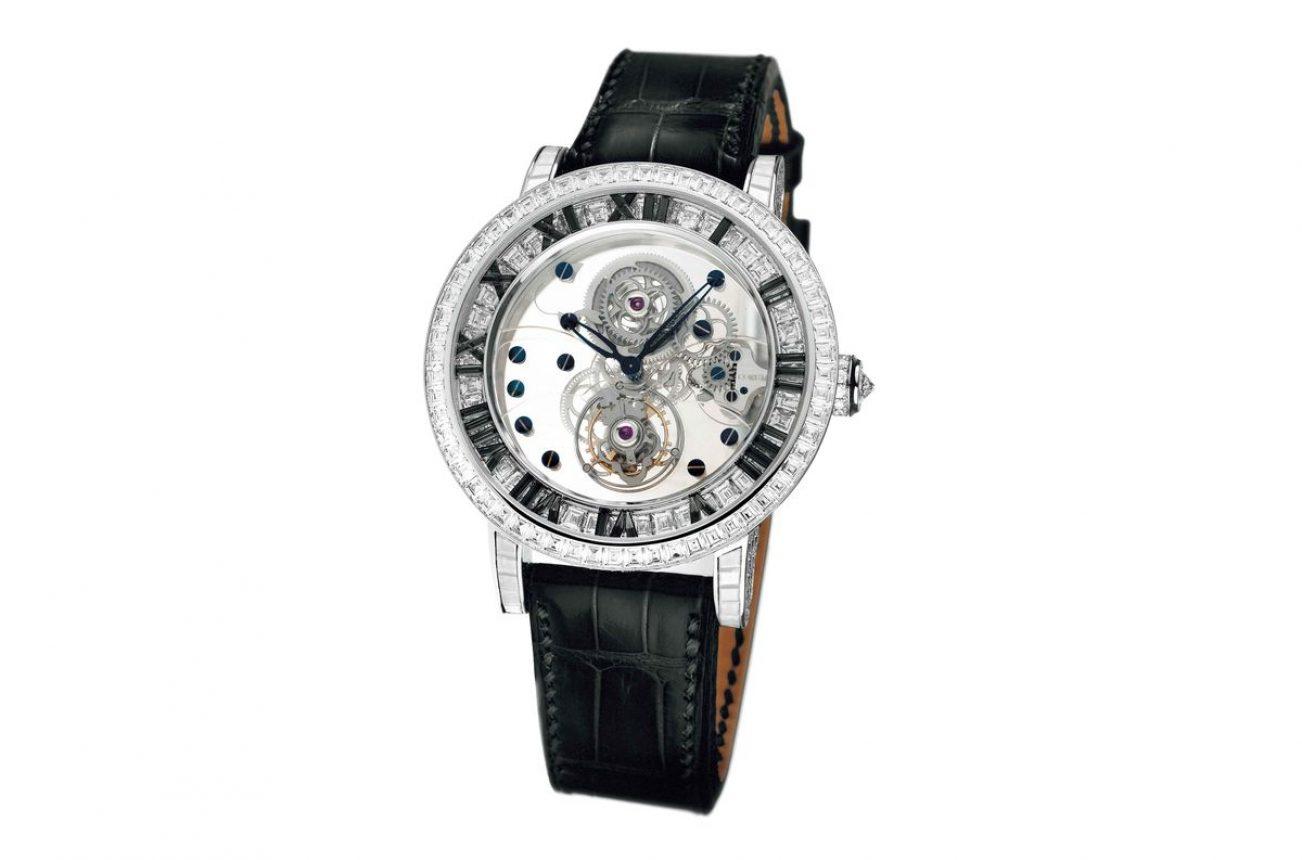 Heritage億萬富翁陀飛輪腕錶,18K白金錶殼,鑲鑽768顆(約14.08克拉),錶徑39毫米,時、分、小秒針、陀飛輪,CO 372手動上鍊機芯,動力儲存90小時,藍寶石水晶玻璃鏡面及底蓋,防水30米,鱷魚皮錶帶,參考售價:13,177,000。