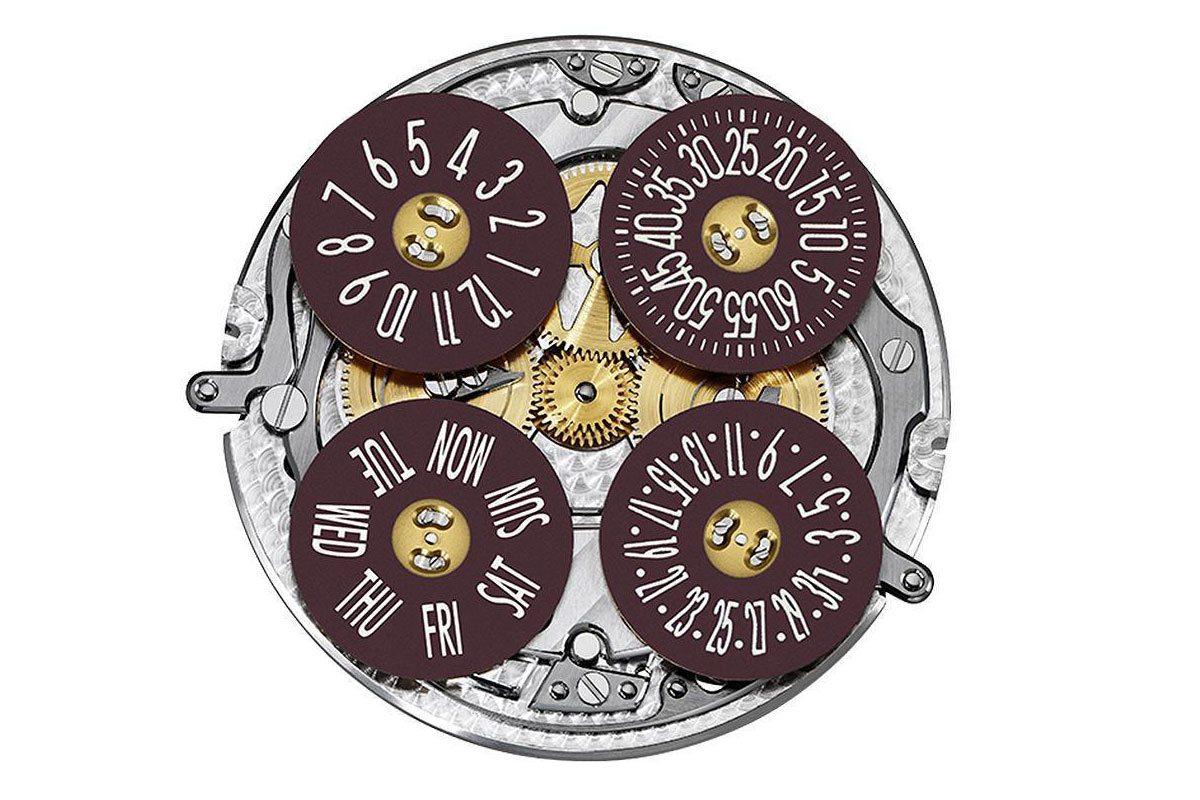 江詩丹頓自製2460 G4自動上鍊機芯,時、分、日期與星期各自獨立呈現。